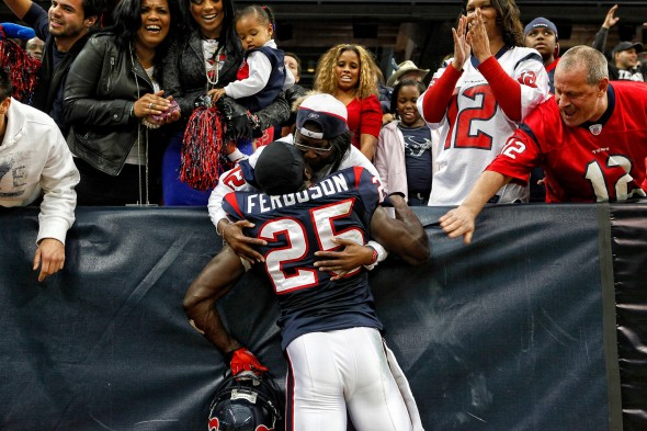 Texans safety Nick Ferguson, 25, embraces Emily Jones, mother of Texans wide receiver Jacoby Jones