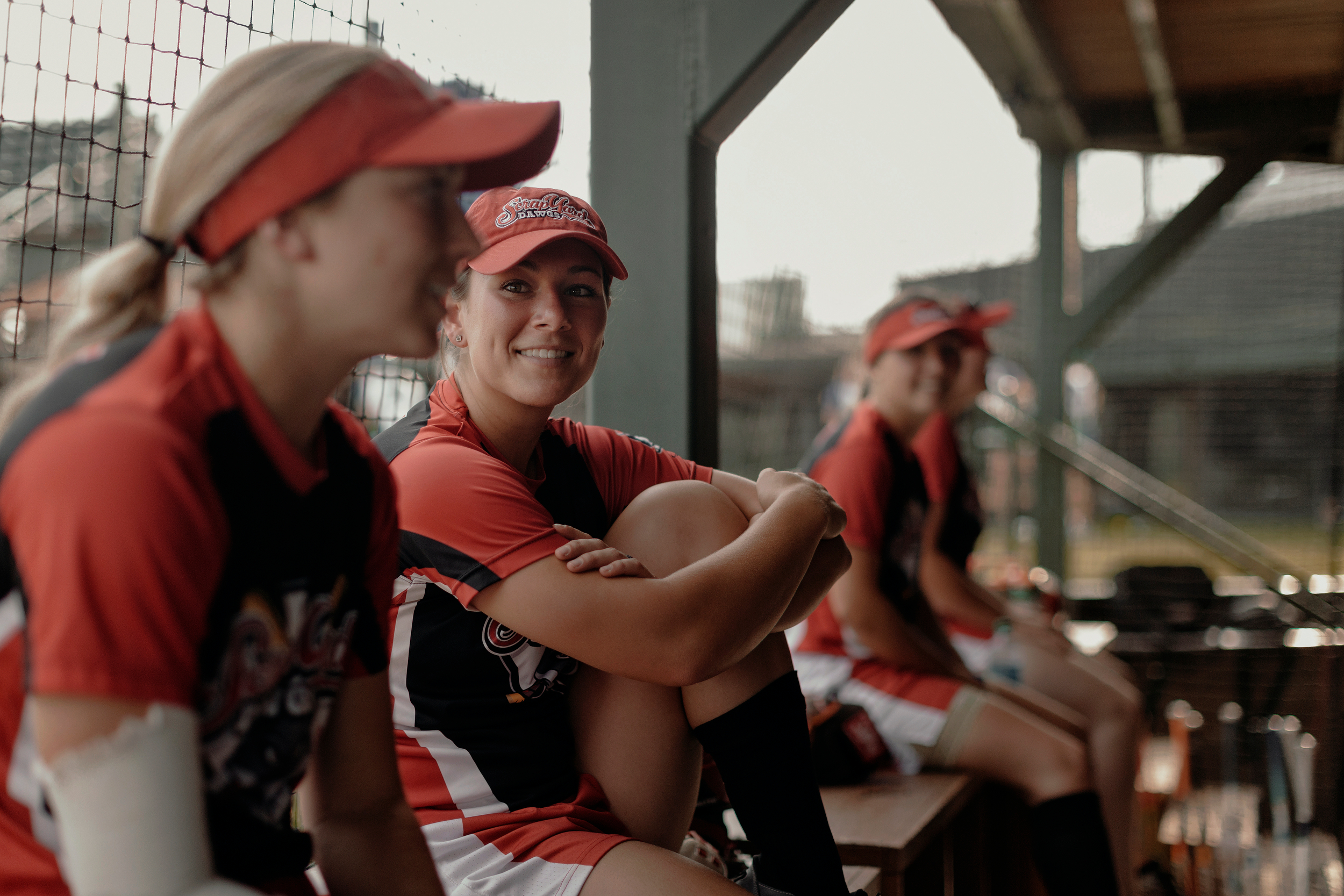 Catcher, Lee Ann Spivey, center, shares stories with her teammates prior to the game. Todd Spoth for The New York Times.