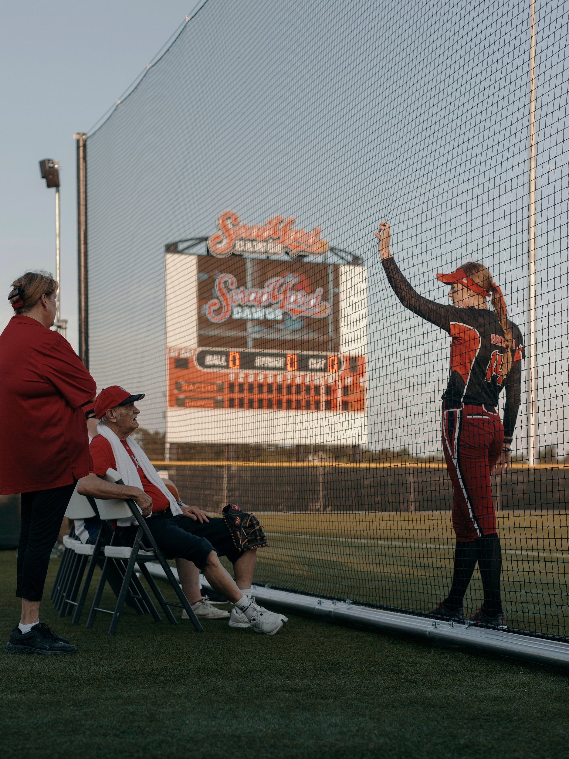 Pitcher, Monica Abbott, talks with elderly fans before the game. Todd Spoth for The New York Times.