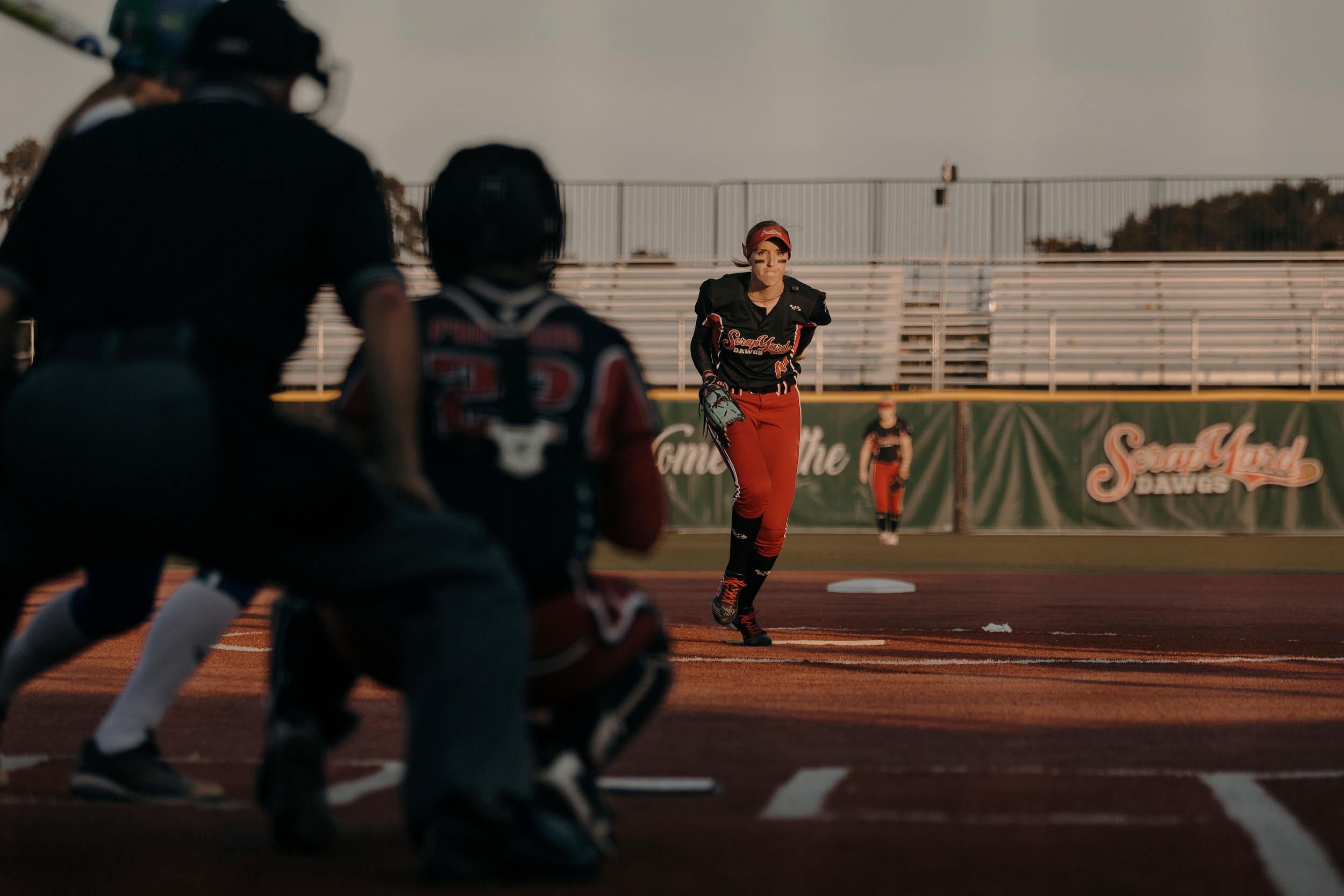 Monica Abbott, 14, takes her first pitch against the Dallas Charge. The Scrap Yard Dawgs won the game 1-0. Todd Spoth for The New York Times.