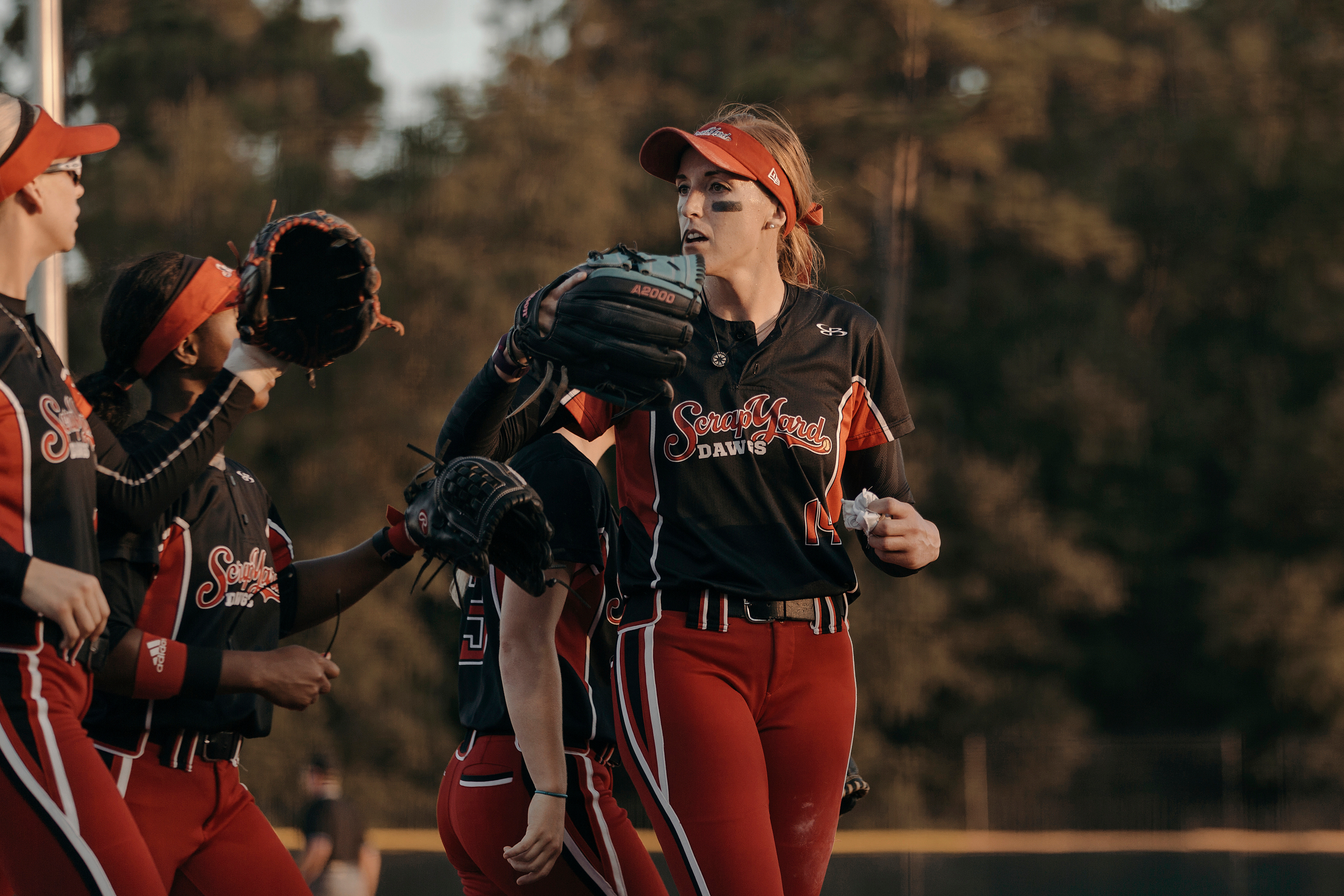 Pitcher, Monica Abbott, congratulates teammates following a play. The Scrap Yard Dawgs won the game 1-0. Todd Spoth for The New York Times.