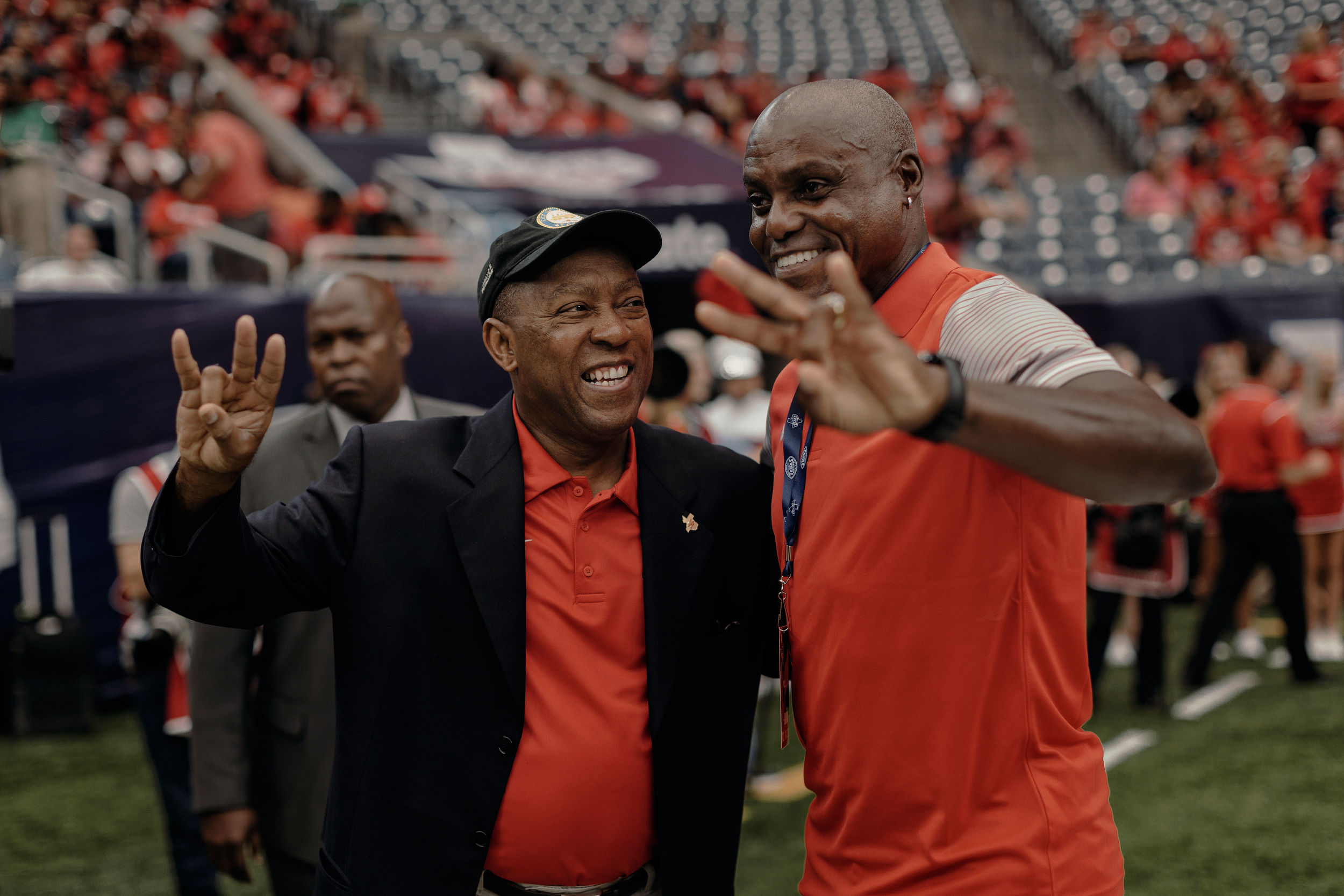 Houston mayor, Sylvester Turner smiles at former US olympian and University of Houston graduate, Carl Lewis, while both pose for a photo prior to the game. Todd Spoth for The New York Times.