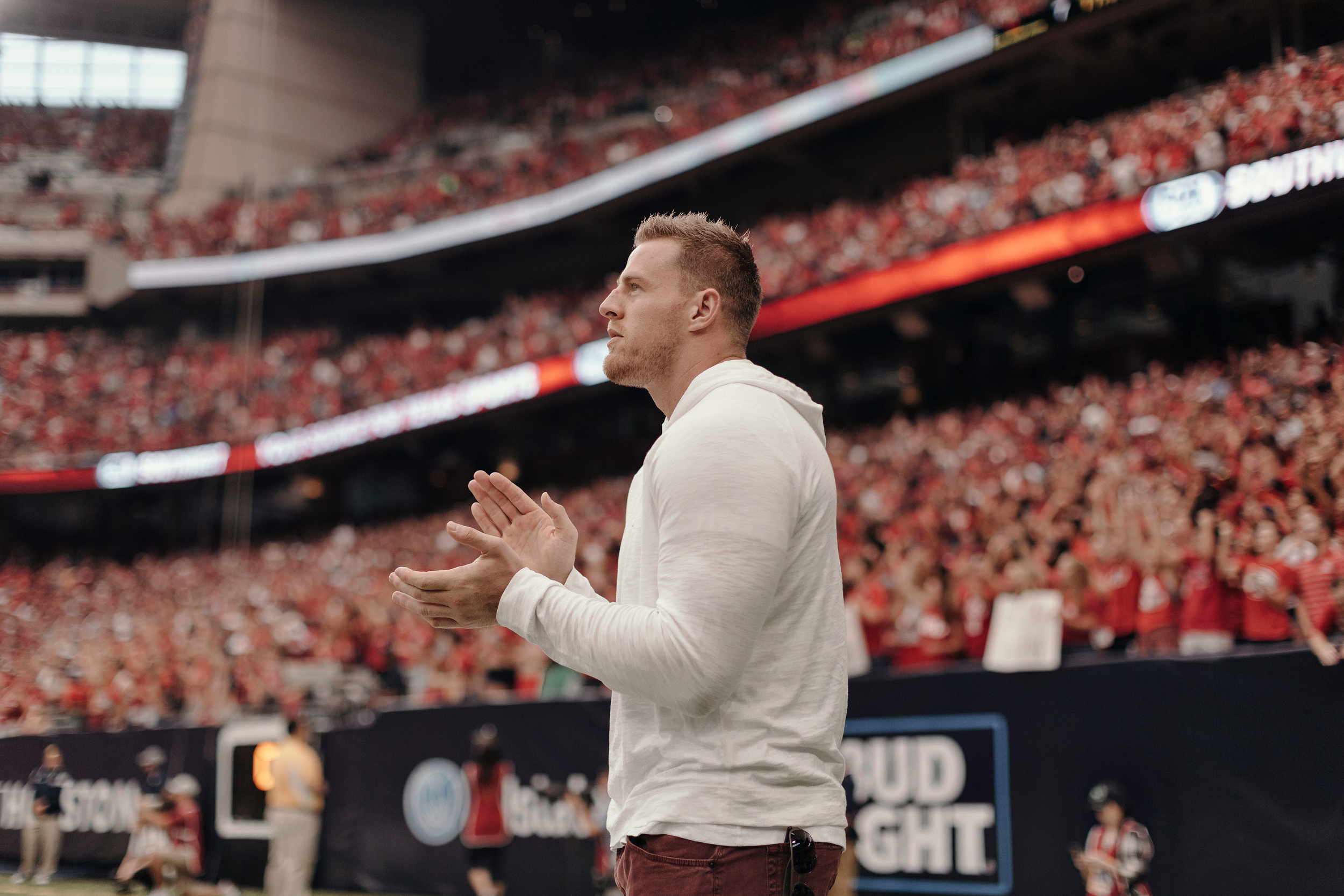 Houston Texan, JJ Watt, watches the game from the sidelines. Todd Spoth for The New York Times.