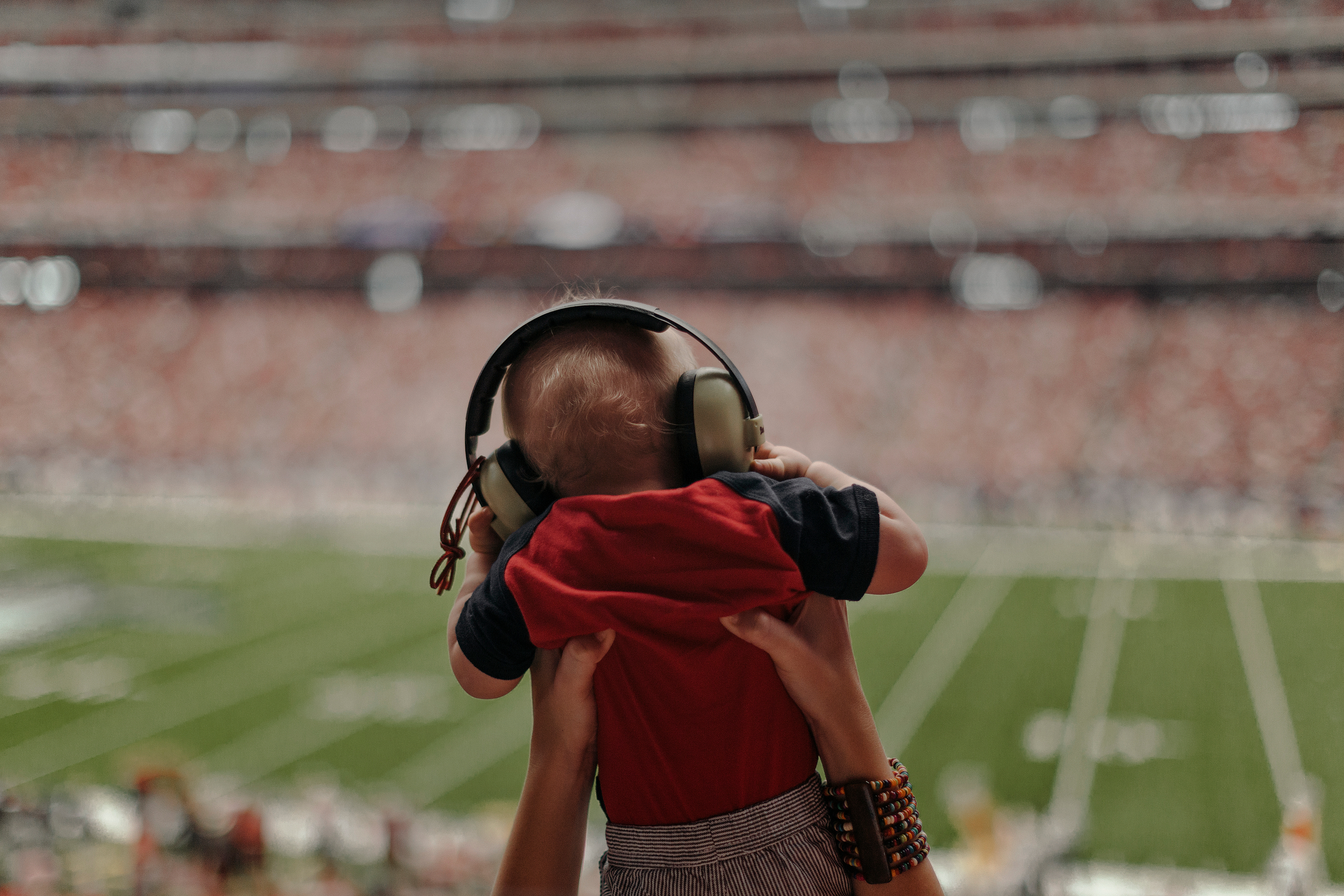 A baby watches the game from his mother's arms. Todd Spoth for The New York Times.