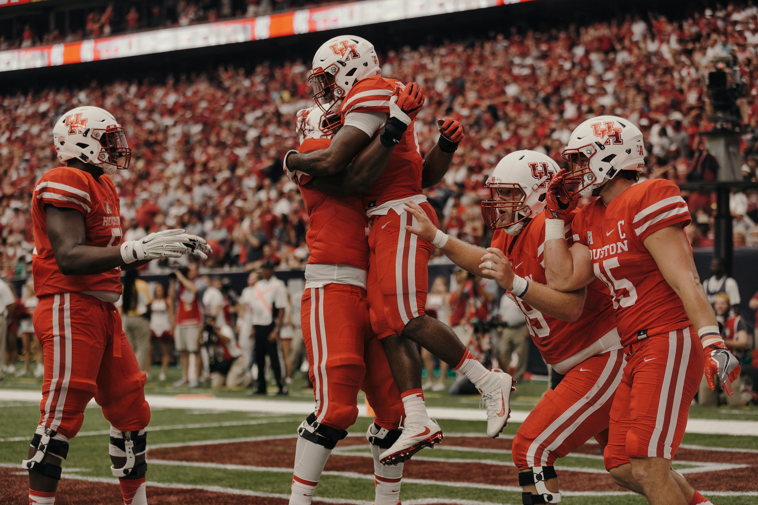 The University of Houston team celebrates an early touchdown. Todd Spoth for The New York Times.