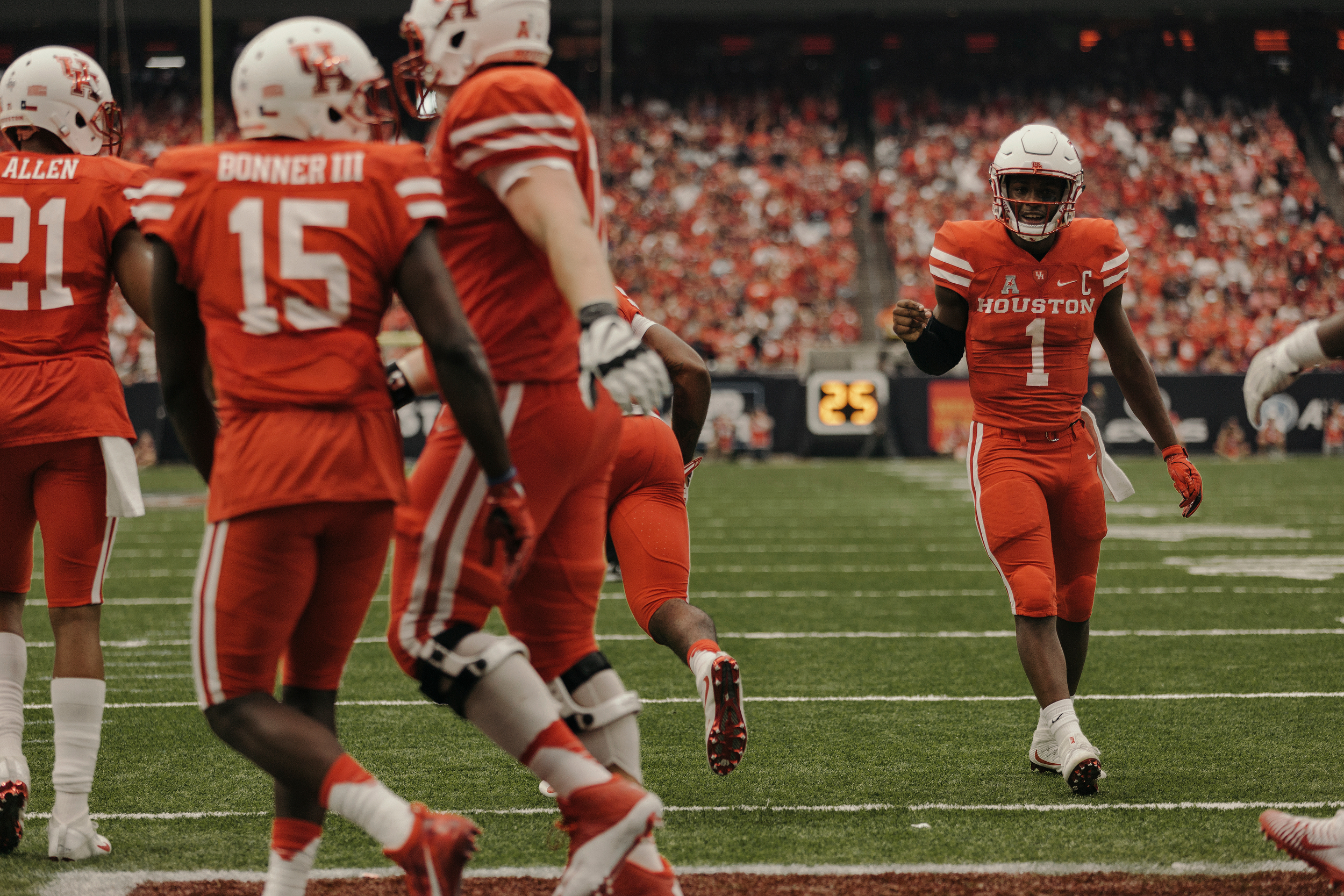 University of Houston quarterback, Greg Ward Jr., Celebrates an early touchdown with his teammates. Todd Spoth for The New York Times.