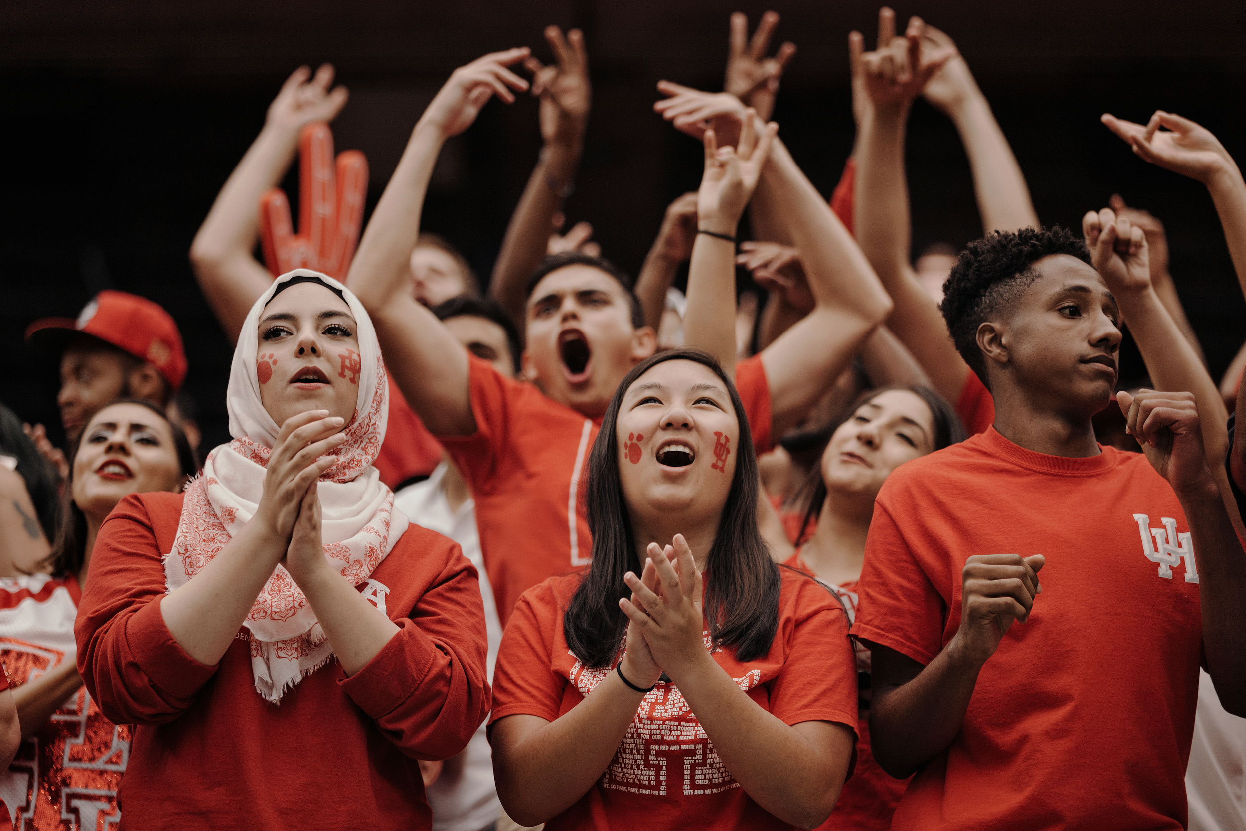 University of Houston fans cheer on their team from the sidelines. Todd Spoth for The New York Times.