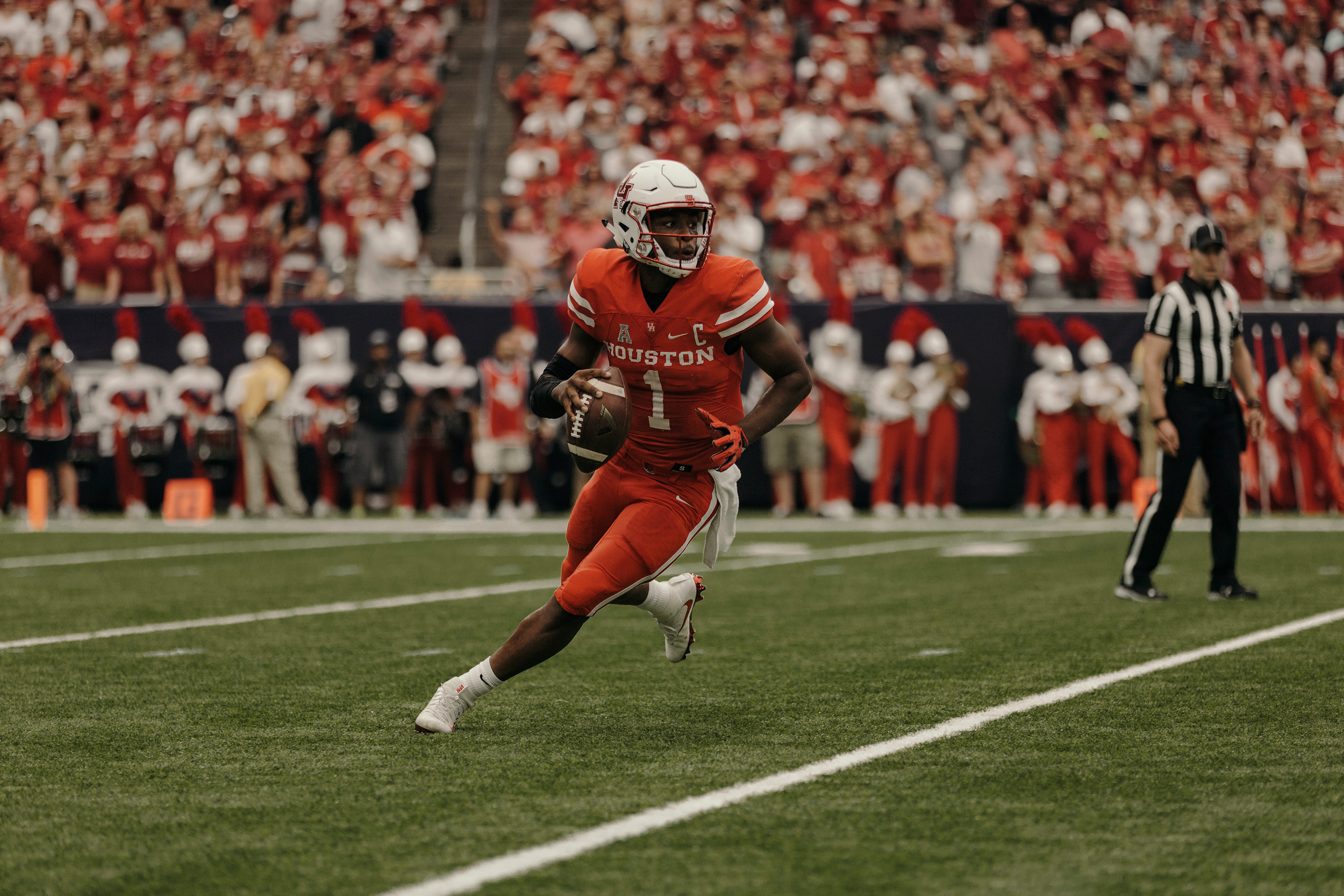 University of Houston quarterback, Greg Ward Jr., scrambles out of the pocket during the first half. Todd Spoth for The New York Times.